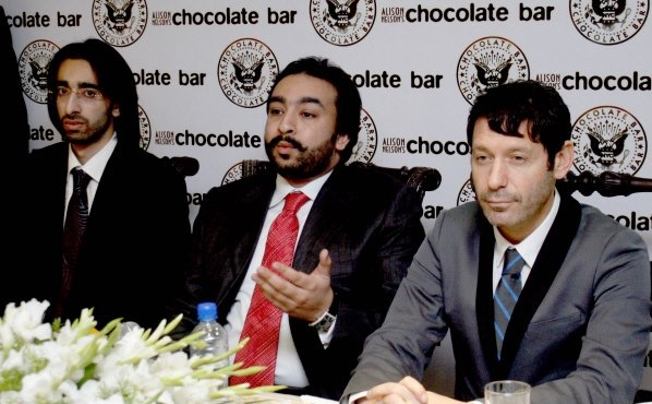 Alison Nelson's Chocolate Bar expands to Pakistan. Alison Nelson's Chocolate Bar, the award-winning, New York-based chain of cutting-edge gourmet cocoa emporiums, launching the first of 22 premium Chocolate Restaurants in Pakistan through partnership with HFK (Pvt.) Ltd. Mr. Hassan Khan Chairman HFK (Pvt.) Ltd. (middle) and Mr. Adam Nelson, Chairman, Alison Nelson's Chocolate Bar (right) announced bringing first American chocolate brand to fully establish chain of luxury chocolate destination, savory restaurant lounges & premium chocolate factory in Pakistan this year.